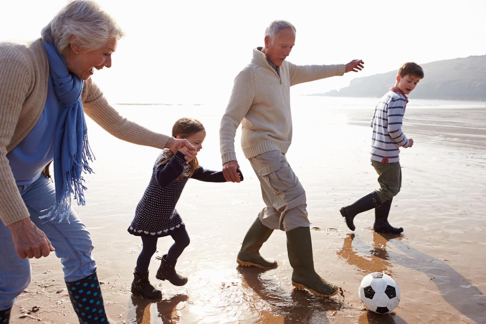 Grandparents enjoying Grandkids on beach stress free ATO